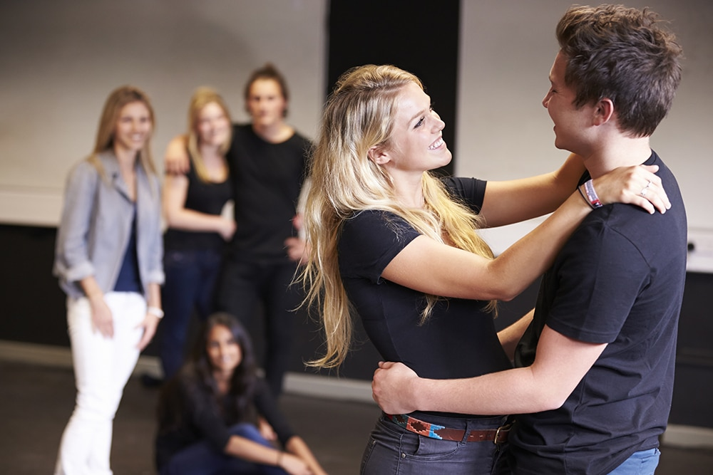 Students Taking Acting Class At Drama College Dancing
